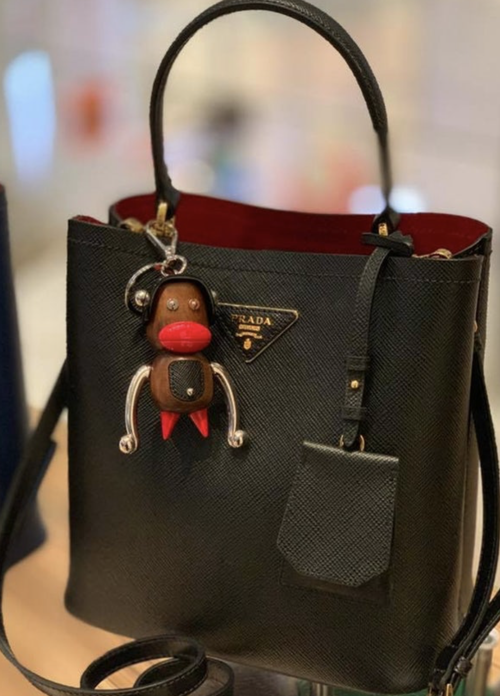 d1675cff75 Prada came under fire in December of 2018 after creating a monkey keychain  that referenced stereotypical black features in a derogatory manner.