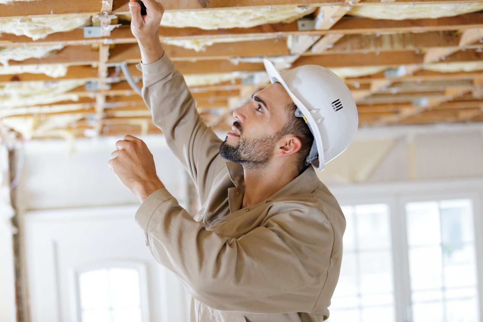 construction worker working on ceiling joist