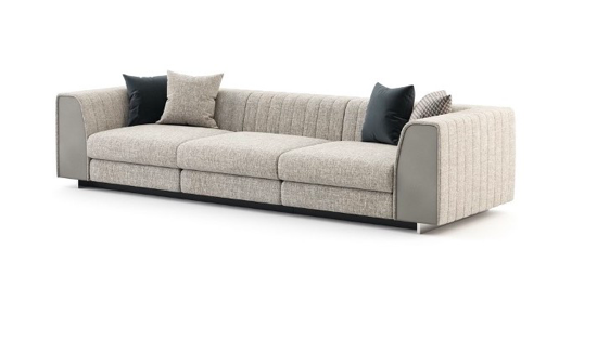A grey couch with pillows  Description automatically generated with medium confidence