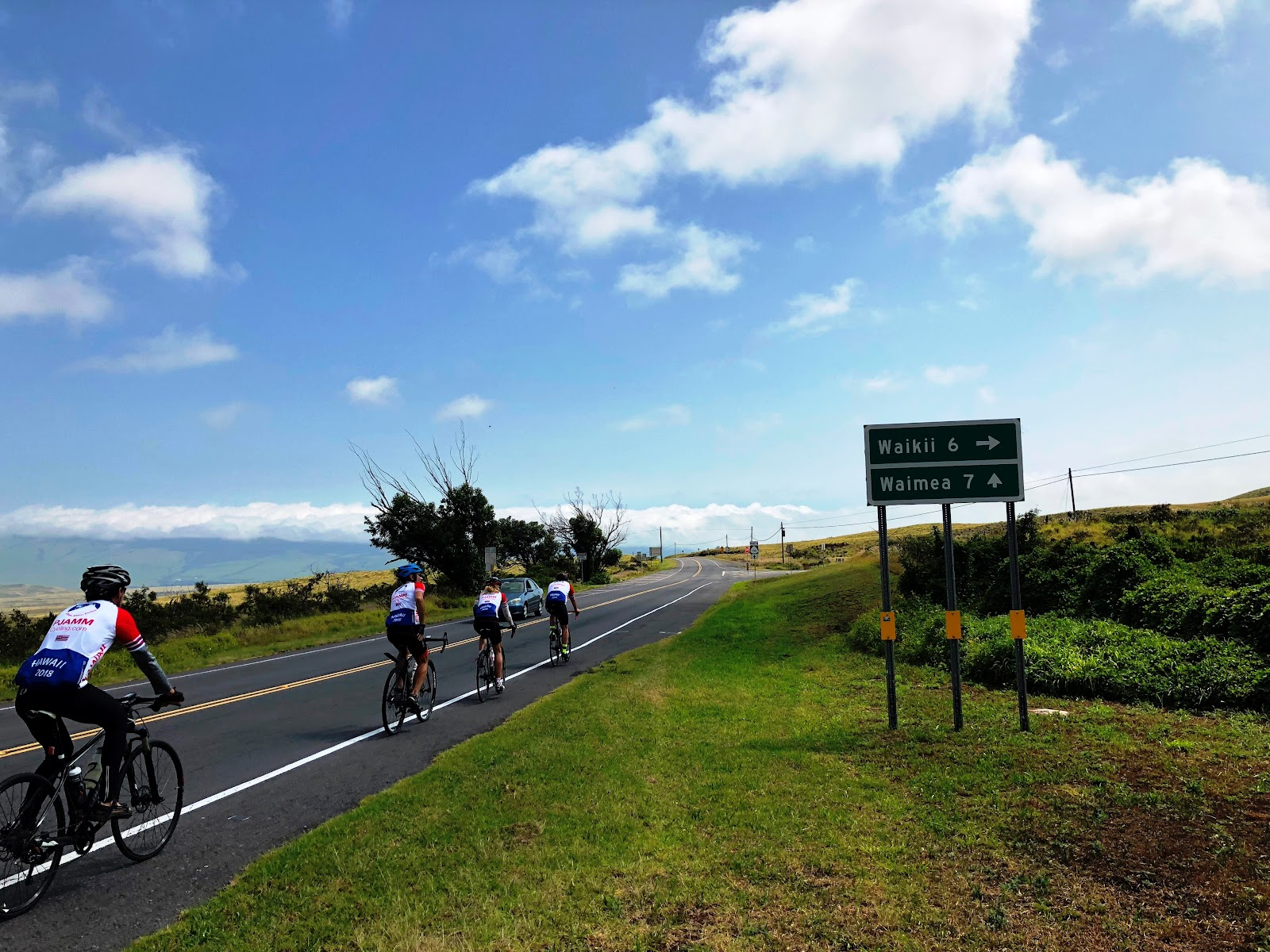 Climbing Mauna Loa Volcano by bike  - cyclists on Hwy 190