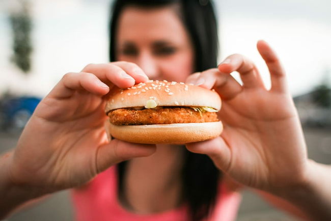 women eating burger