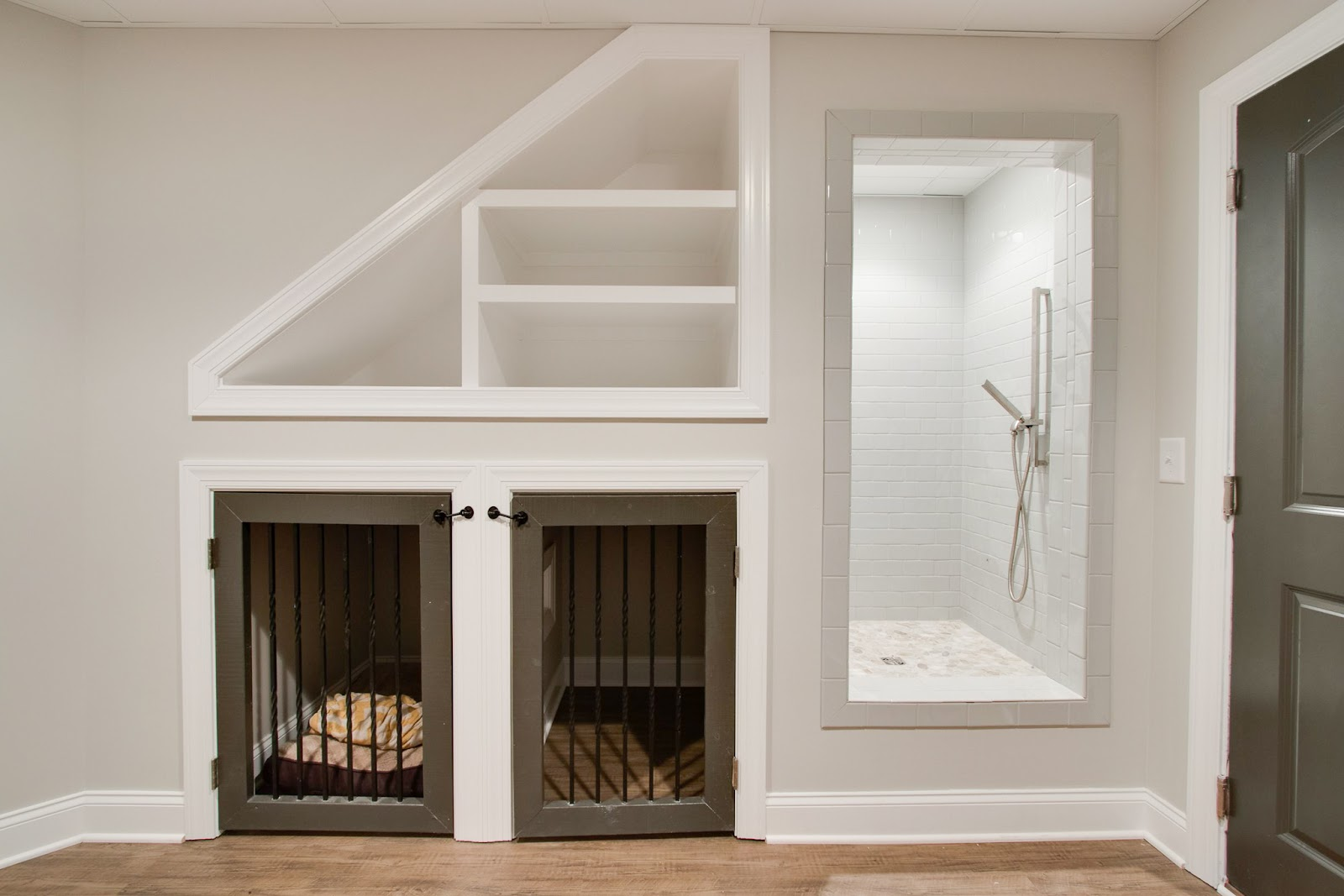 understairs two dog homes blankets dog wash shower builtin renovation superior construction and design