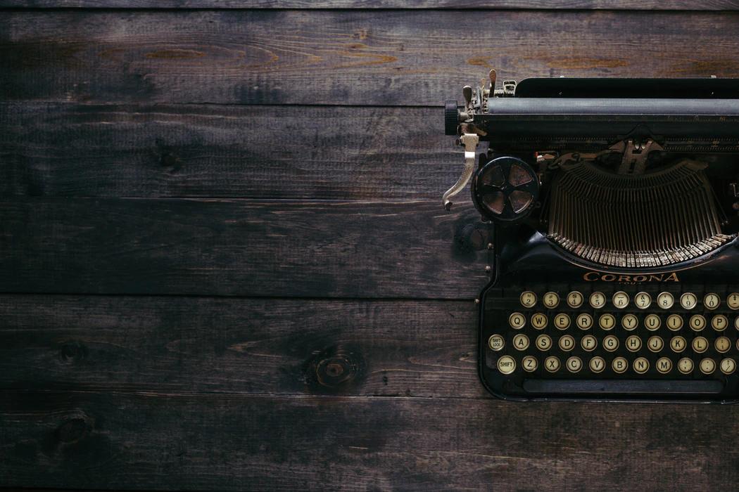 Antique Typerwriter on Dark Wood