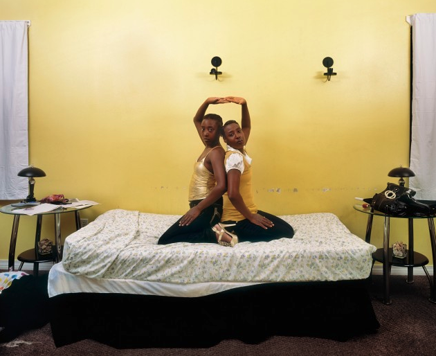 two people on a bed