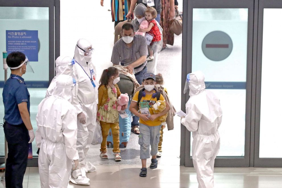 PHOTO: Evacuees from Afghanistan arrive at Incheon International Airport on Aug. 26, 2021 in Incheon, South Korea.