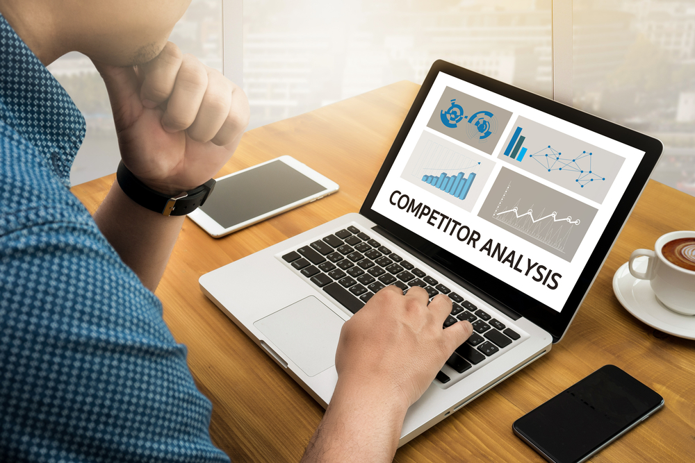 person doing a competitor analysis