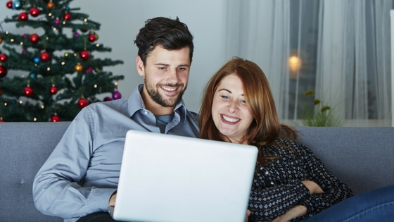 a couple watching something together on a laptop