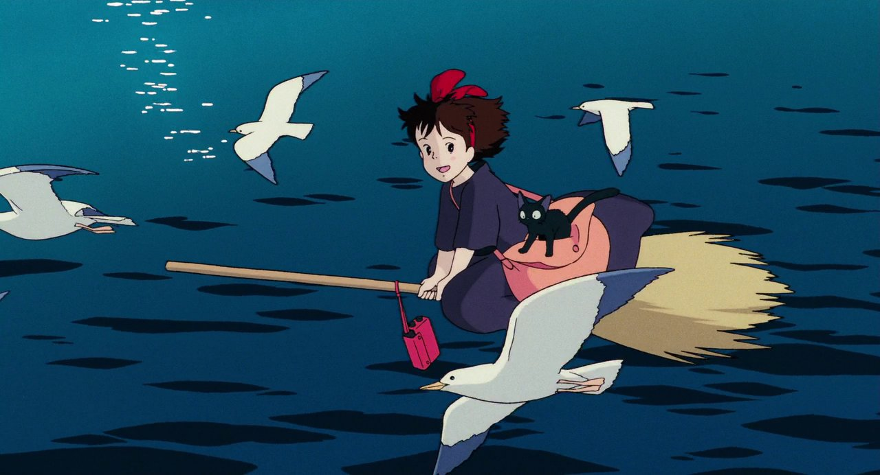 Image of a young girl flying on a broomstick over water