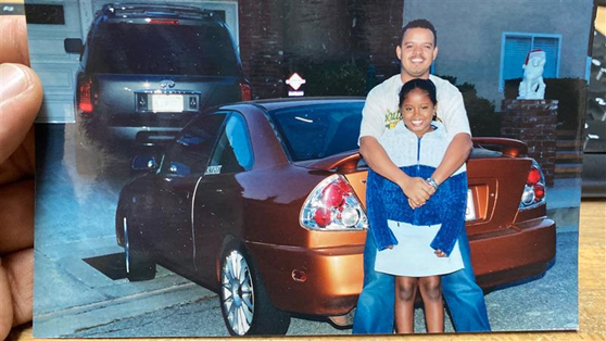 Manny and daughter in front of his 2001 Mitsubishi Mirage