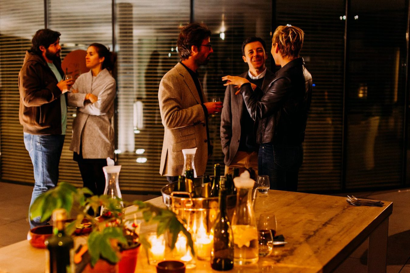 People networking in a darker room