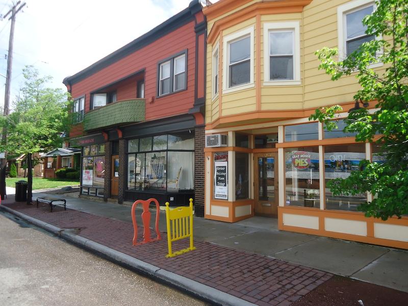 orange storefronts on Larchmere street