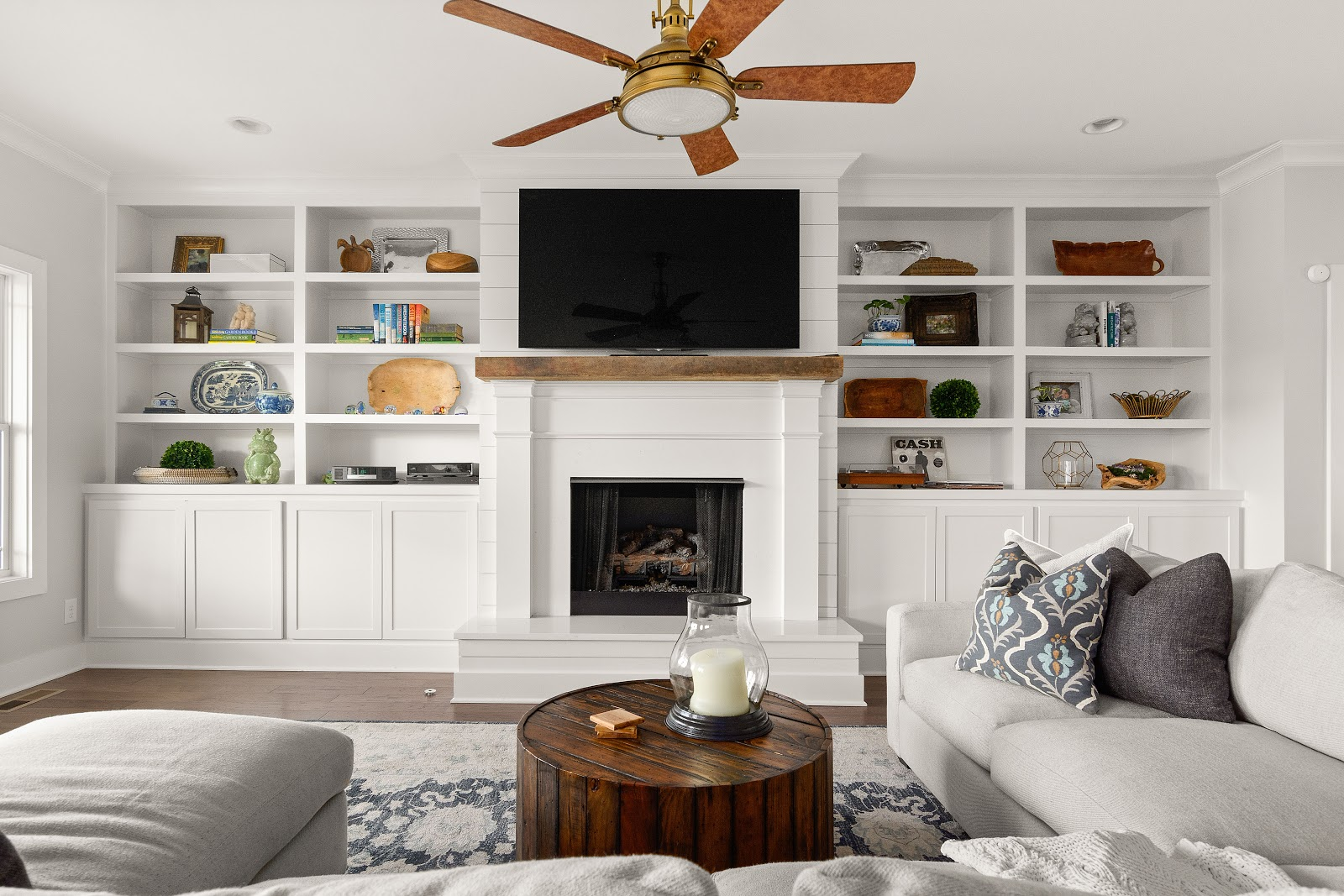 lake house tn built-in book shelves cabinets around fireplace timeless look white