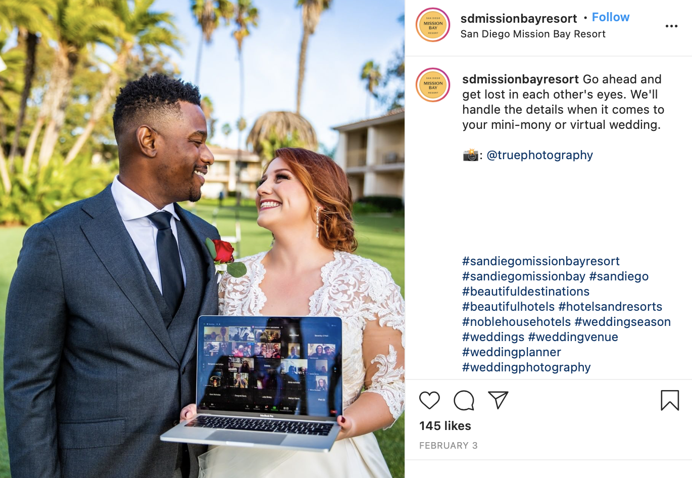 married couple holding laptop for virtual wedding