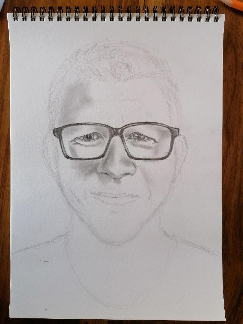 A person wearing glasses  Description automatically generated