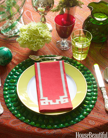 dining table layered with red and green accents