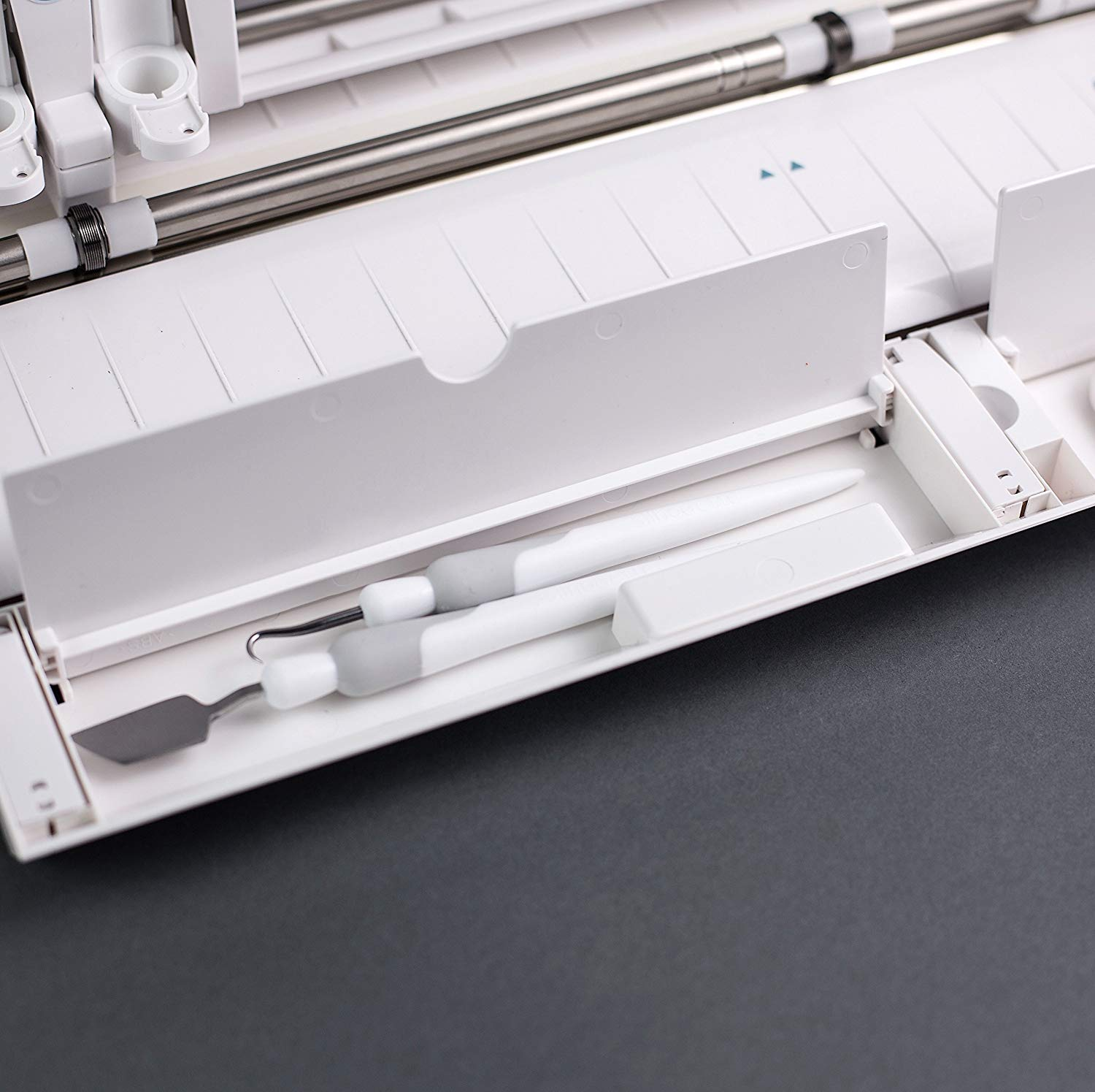 Silhouette Cameo 3 has two hidden compartments. A long one for pens and tools and a short one for pen blades.