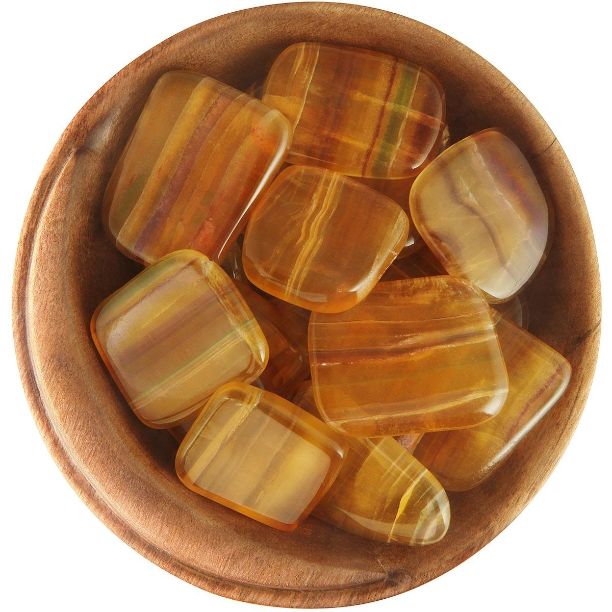 Yellow Fluorite Stones in a bowl with a few rainbow tiger stripes