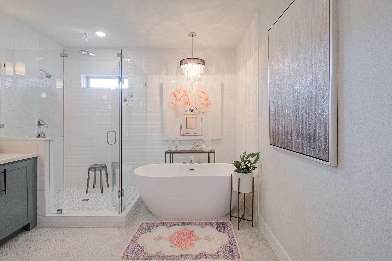 builder-grade home after custom interior design chandelier free standing tub glass shower herringbone tile