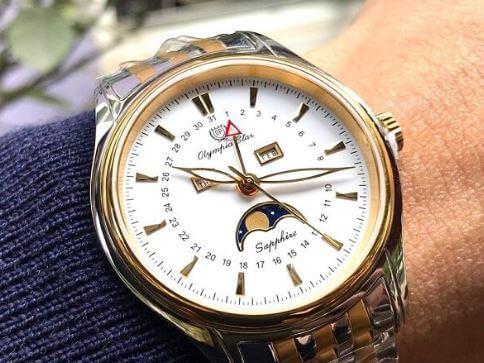 kiểm tra phần đáy đồng hồ Olympia Star