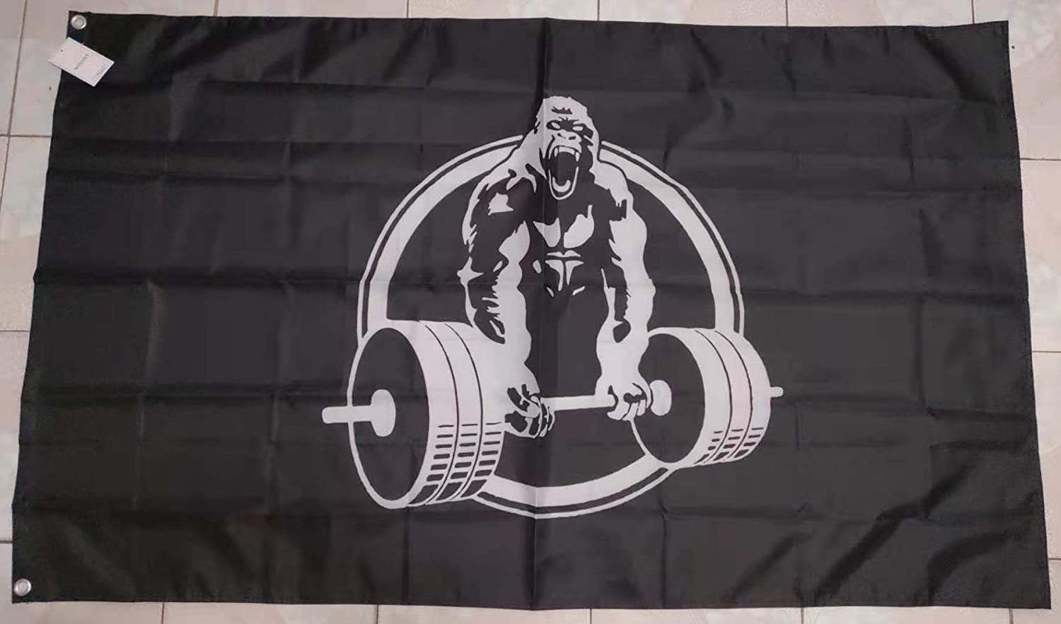 Personalized Gorilla Lifting Logo Garden Flag has the graphic of a gorilla that is lifting weights but offers an option to personlize