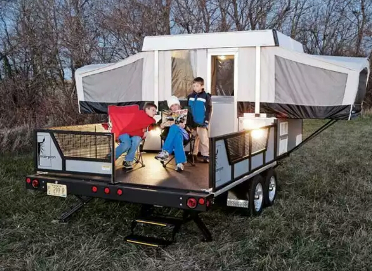 Hauler with double slide out folding camper