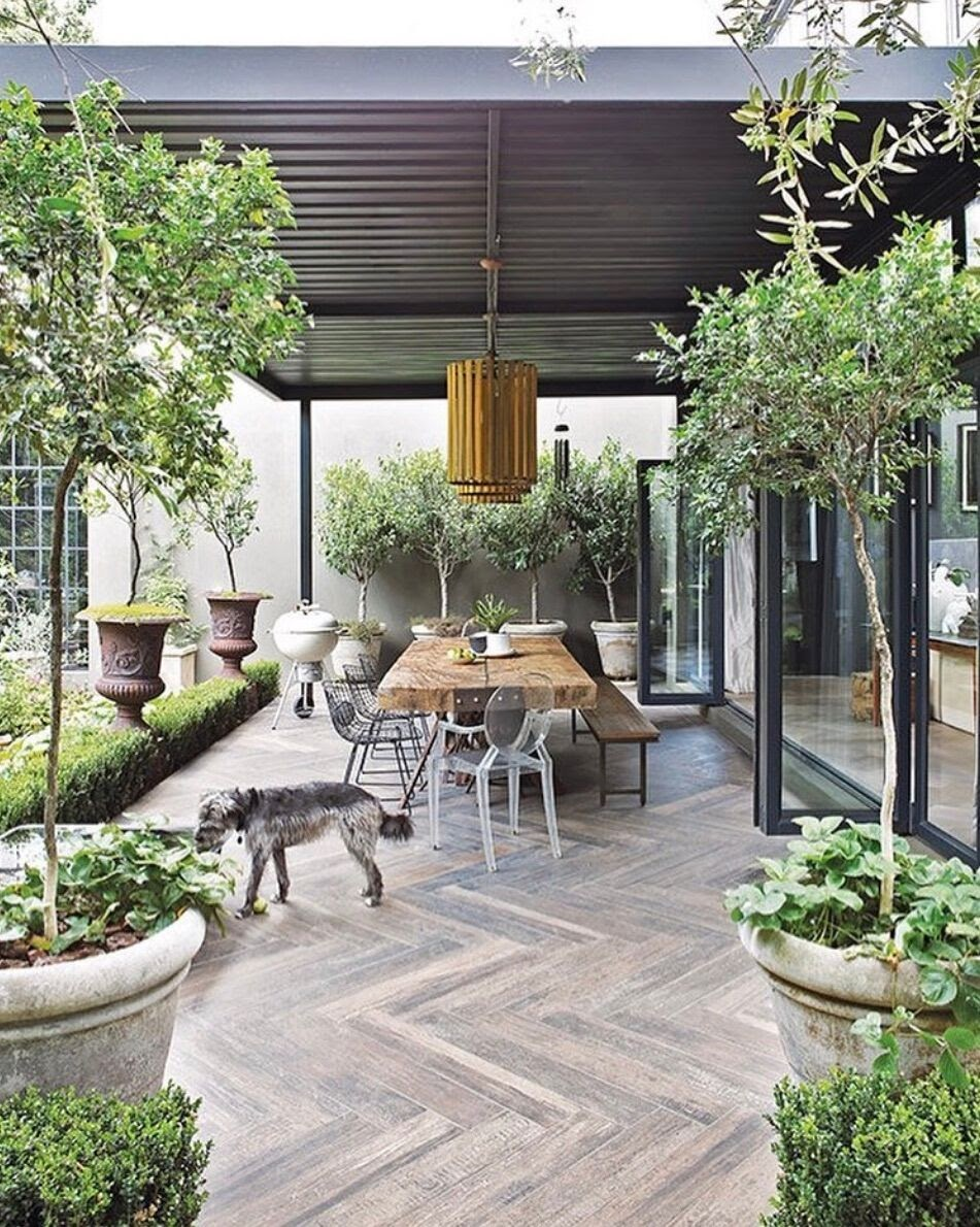 long outdoor table bench gathering  tara fust design vacation vibes at home design atlanta buckhead ga