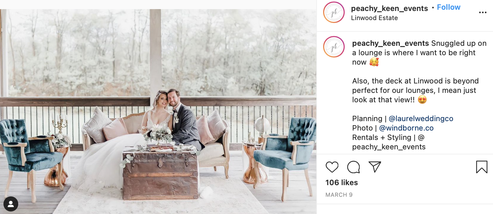 couple sitting on living room furniture at their wedding