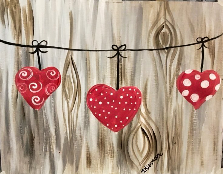 painting of three hearts on a string