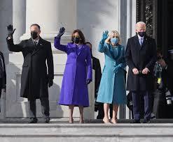 Joe Biden with his wife, Jill Biden, alongside Kamala Harris and her husband, Doug Emhoff on the steps of the Capitol