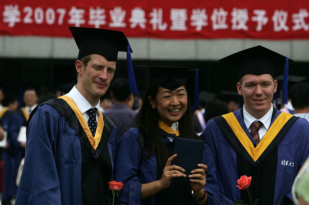 Students graduate during a ceremony held for 3,768 masters and 898 doctorates being given out at the Tsinghua University on July 18, 2007 in Beijing. Tsinghua admits of its own accord to be a training ground for Marxist propagandists who go on to work both in the regime's demagoguery machine and global blue chip corporations