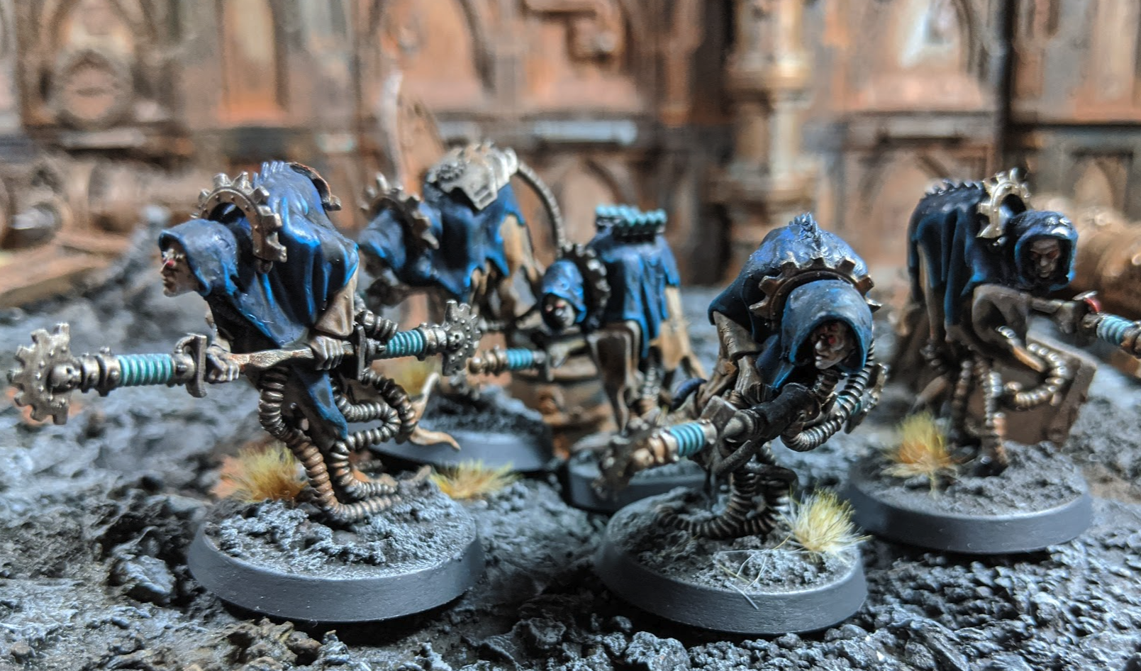Robed 28mm ghostlike miniatures with large electric rods and snaking mechanical tentacles