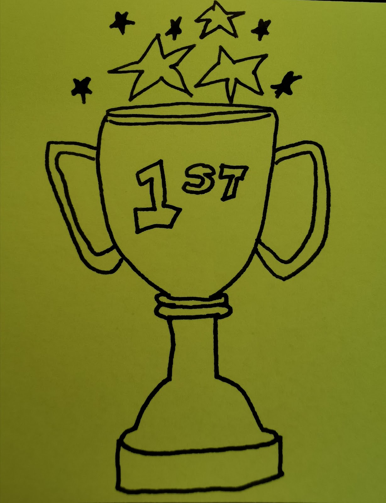 drawing of a trophy with stars coming out of the top