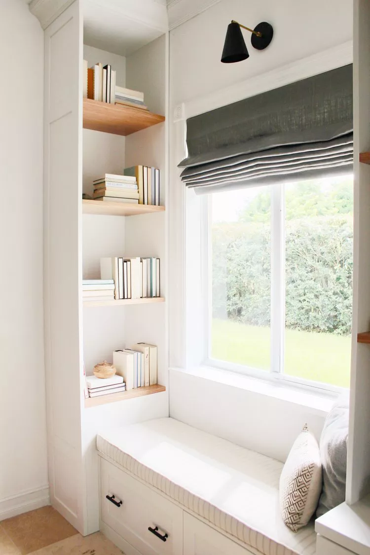 Built-in seating under a window with built in bookcases