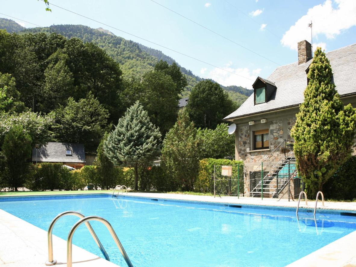 Cool off in this campground's swimming pool after a day hiking through the Catalonian mountains