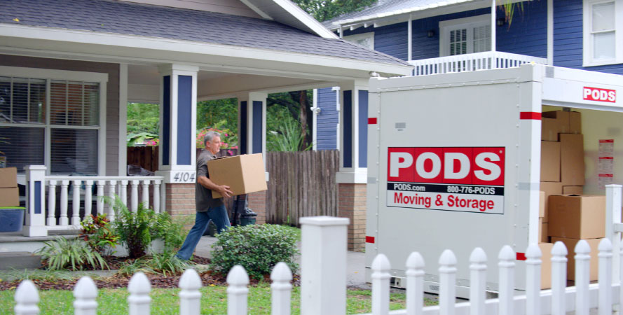 An older man loading a PODS container