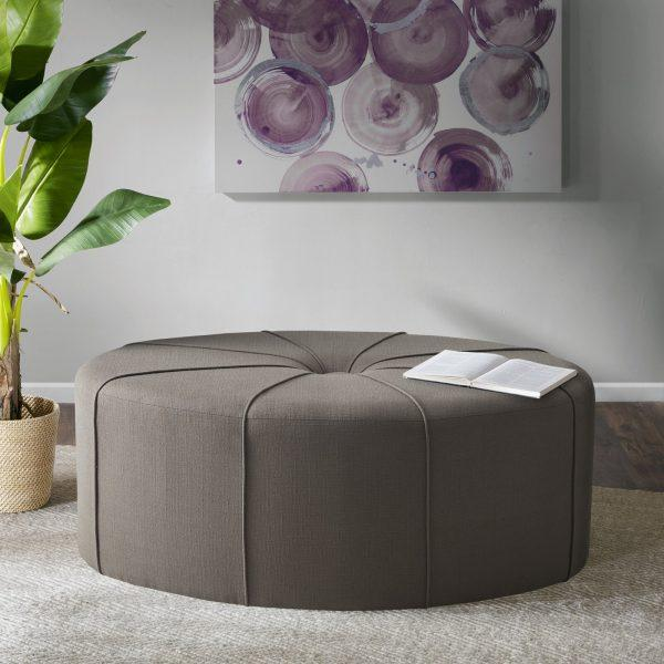 http://cdn.home-designing.com/wp-content/uploads/2021/04/oval-ottoman-coffee-table-with-neutral-brown-upholstery-piped-details-large-tuft-multipurpose-living-room-furniture-ideas-600x600.jpg