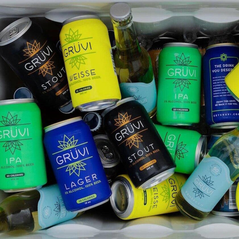 A cooler full of Gruvi beverages, some in cans and some in bottles.