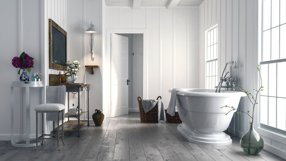 an elegant bathroom featuring a soaking tub