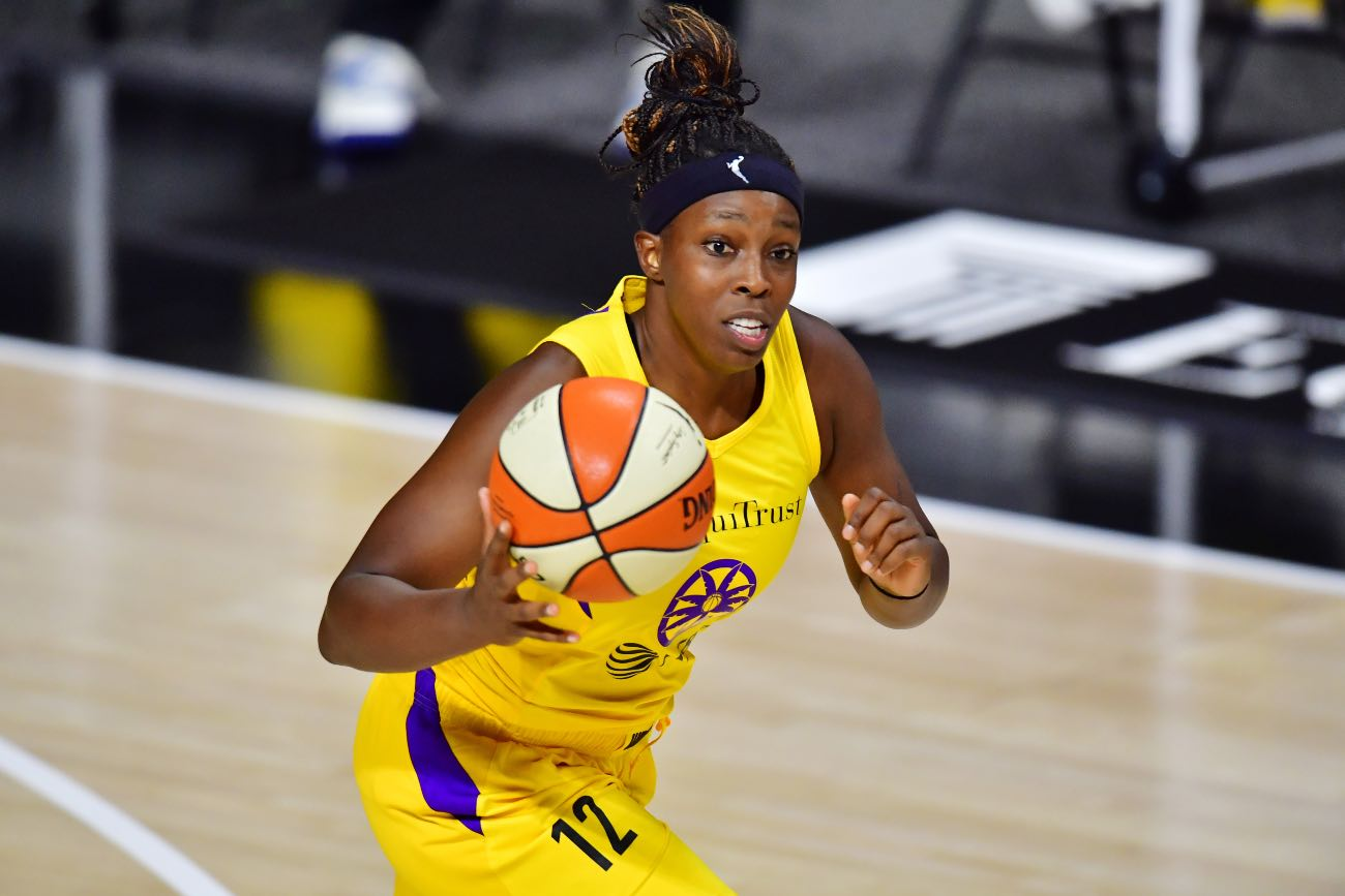 PALMETTO, FLORIDA - SEPTEMBER 06: Chelsea Gray #12 of the Los Angeles Sparks dribbles up court during the second half against the Chicago Sky at Feld Entertainment Center on September 06, 2020 in Palmetto, Florida. (Photo by Julio Aguilar/Getty Images)