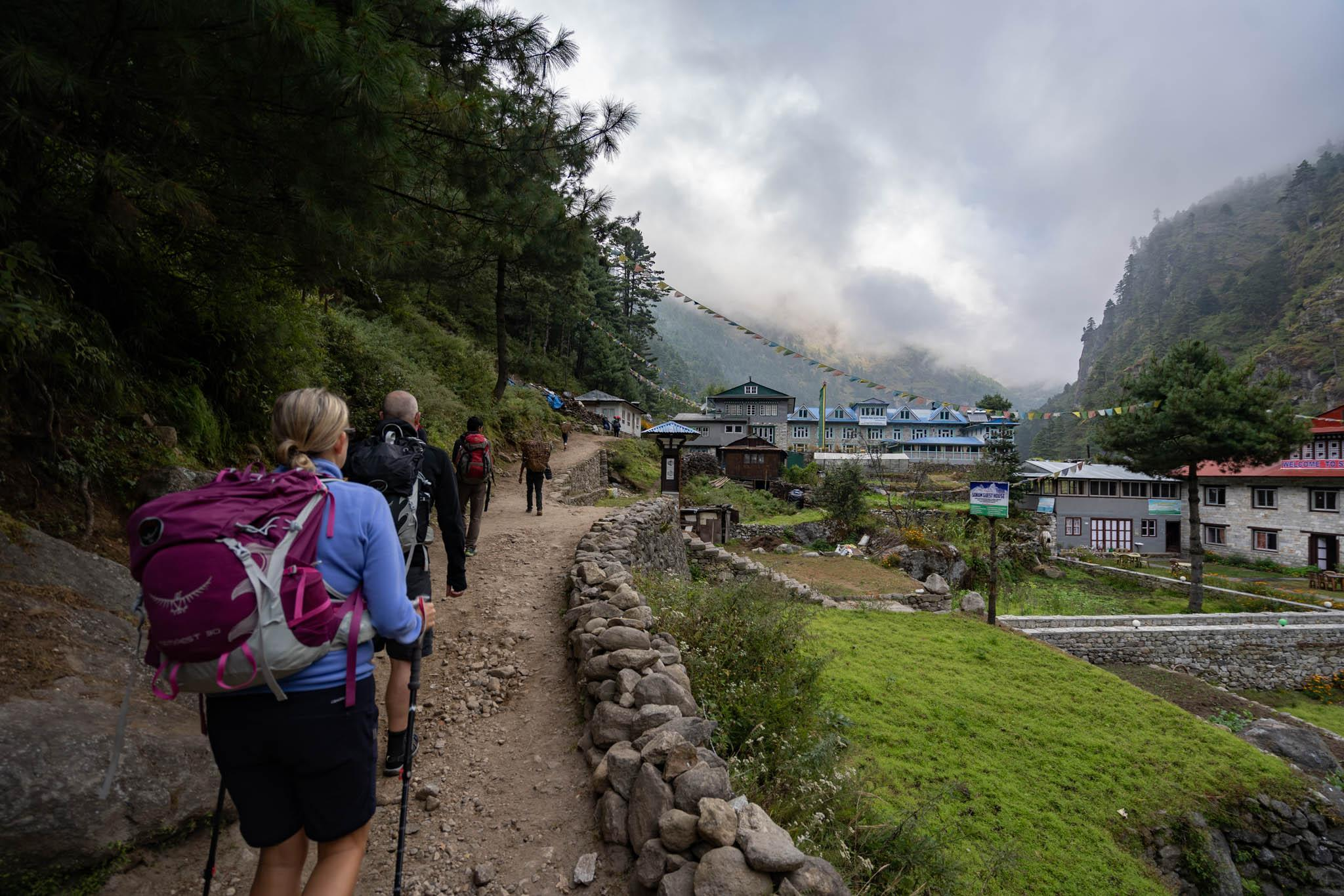 A trekking group arriving at a Nepalese village