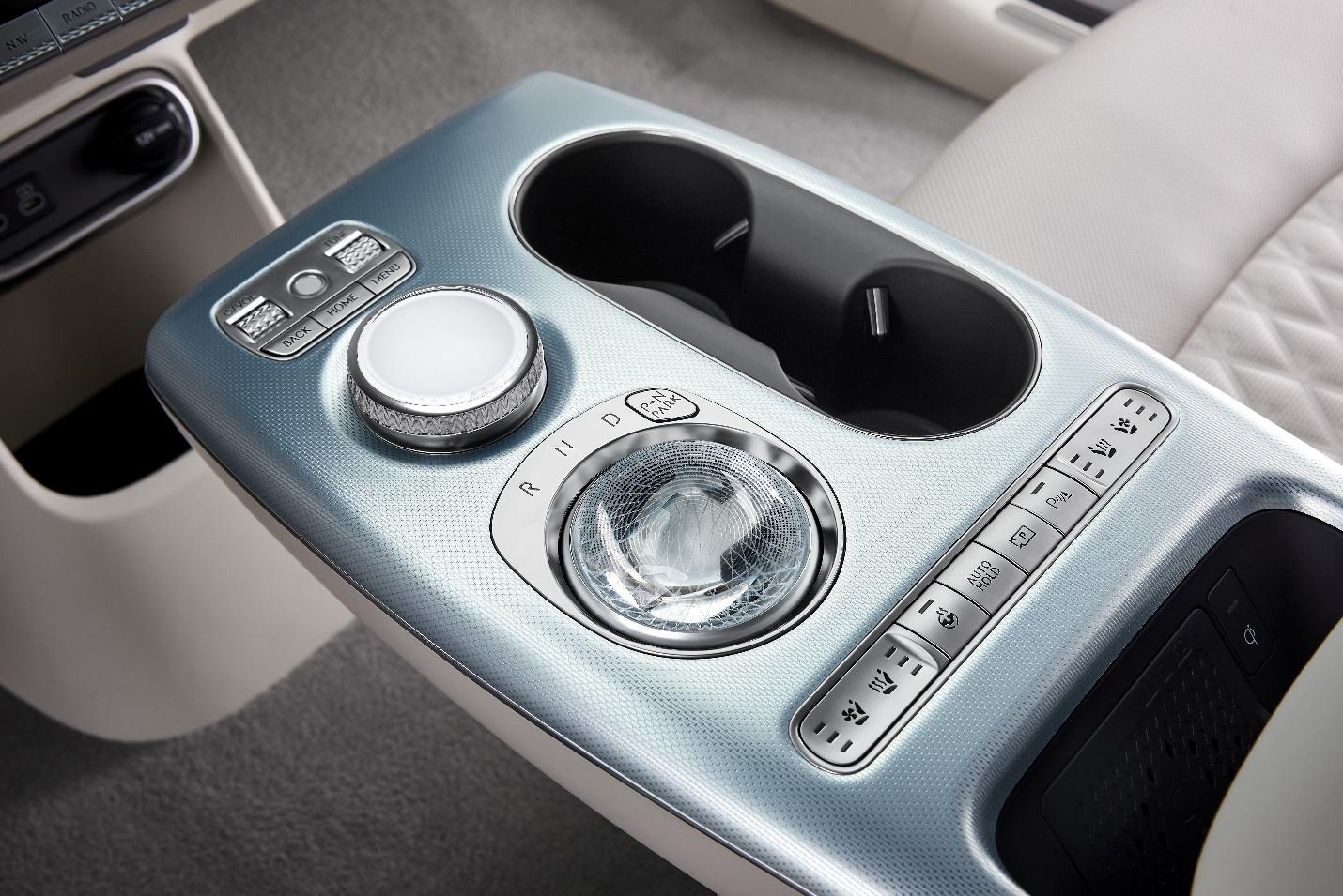 A picture containing indoor, close, gearshift, control panel  Description automatically generated