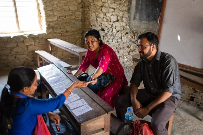 A mobile data collection app designer takes two community health workers through her tool