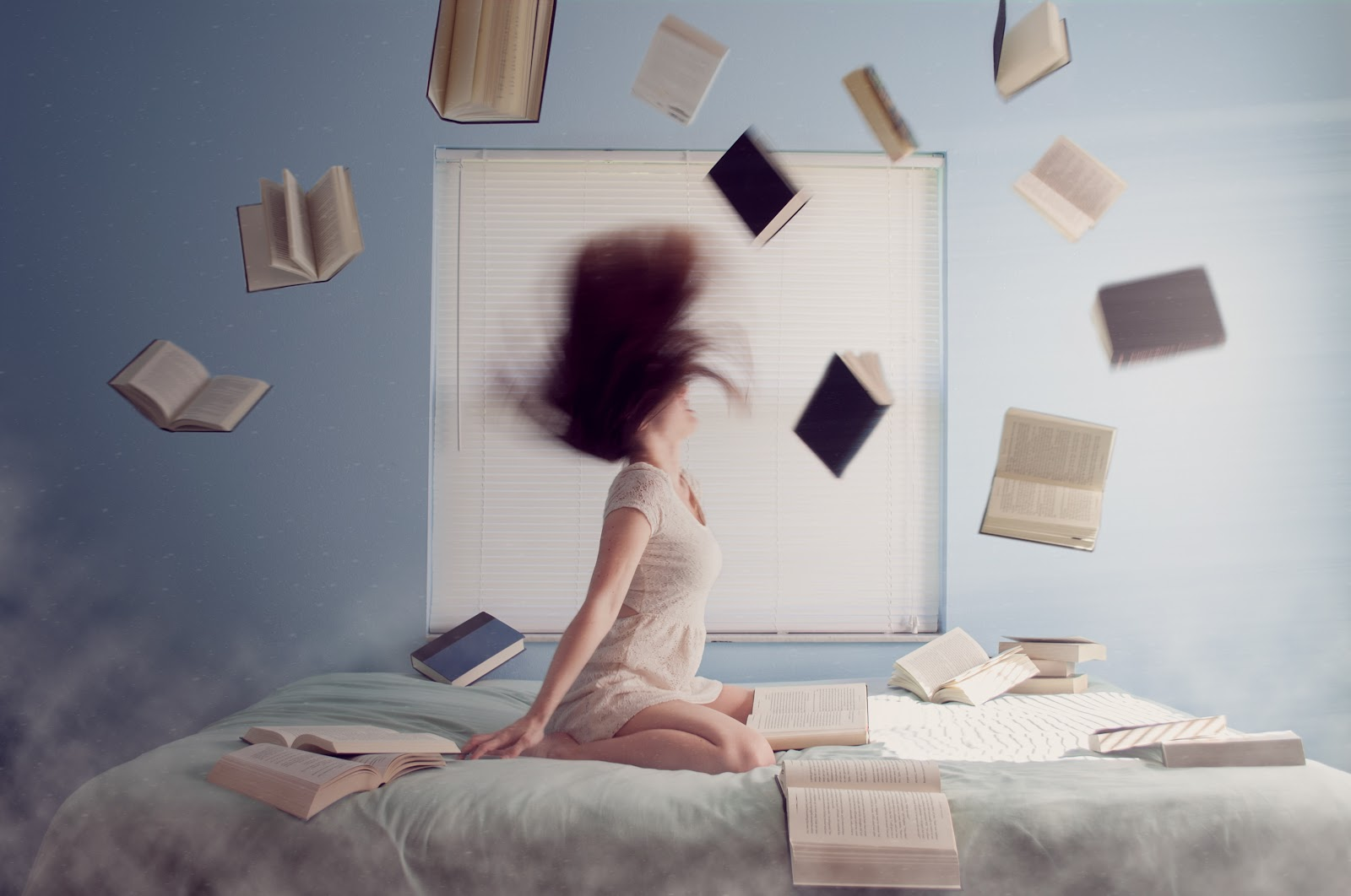 woman shaking head on bed books flying around her when things go wrong