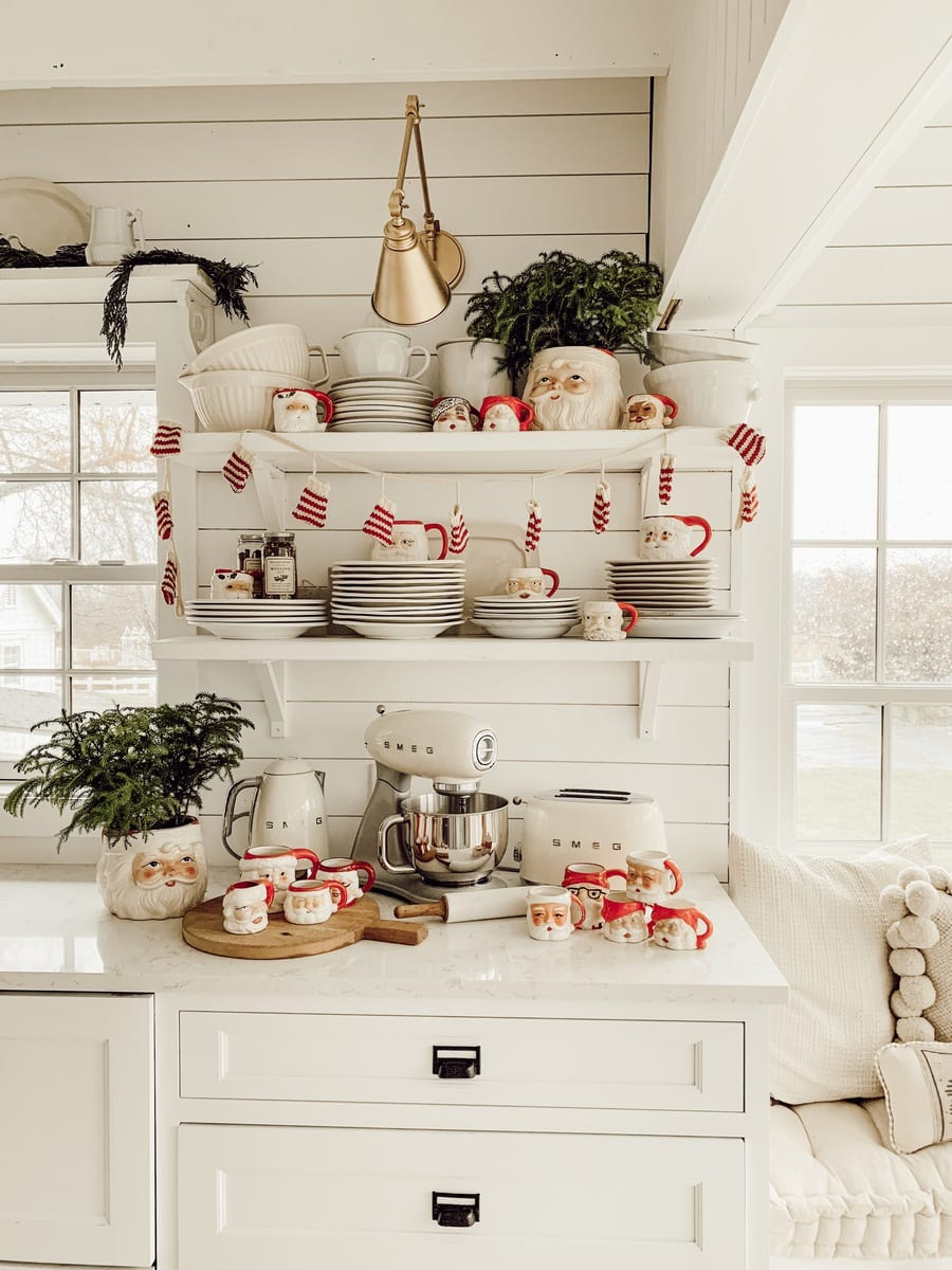 holiday kitchen display with open shelves and a collection of festive santa mugs