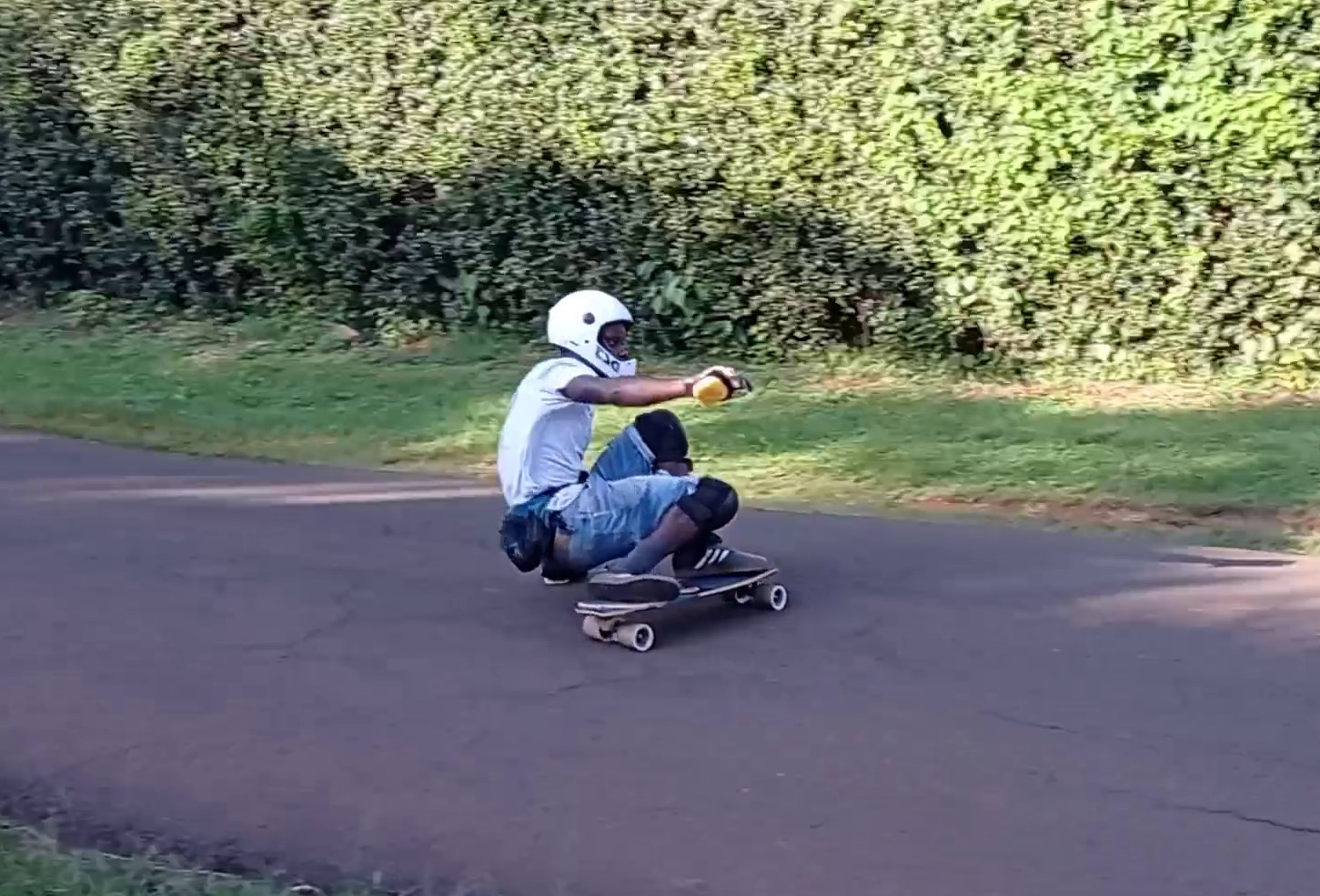 Abuga sliding his longboard on the Pro-Fluxx
