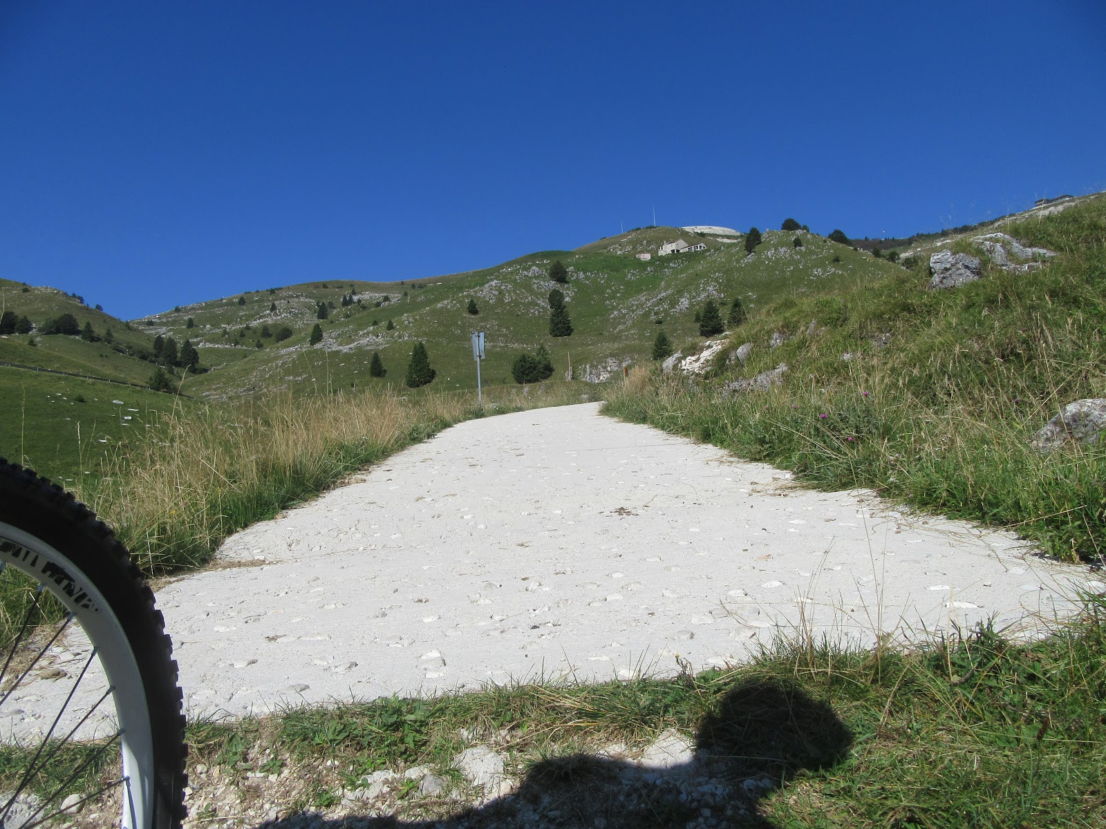 Climbing Monte Grappa from Crespano by bike - start of pavement