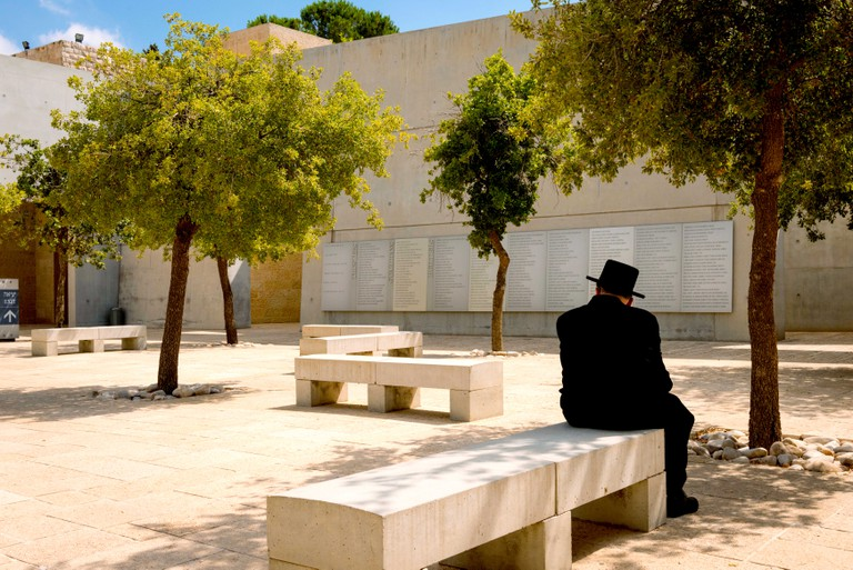 Israel Jerusalem Mount Herzl Yad Vashem old orthodox Jew lost in thought in square honouring the Trustees, Guardians & Builders