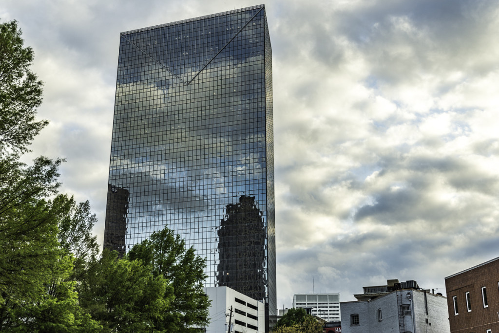 Reflections of the clouds and sky in a glass building