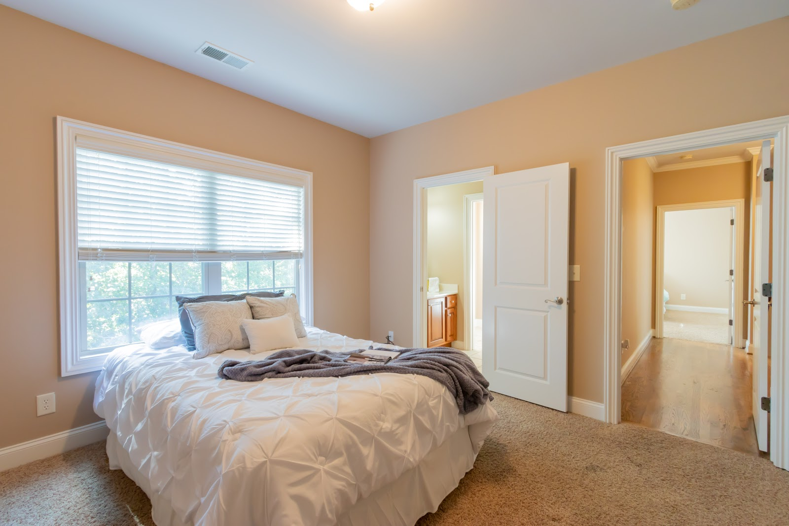 Stage a room by keeping it simple. You want to show buyers how much space there is.