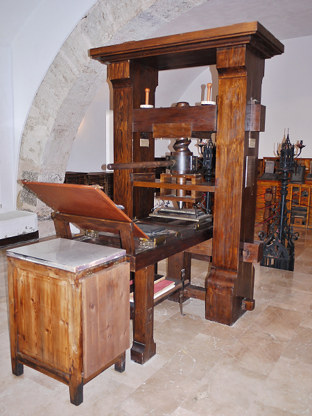 Replica of an early printing press made of wood.